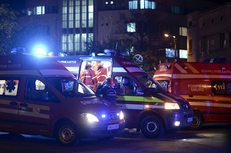 Emergency services work outside a nightclub in Bucharest, Romania October 31, 2015. Twenty five died in a nightclub blast and fire late on Friday and at least 88 people were admitted to hospital, government officials said. REUTERS/Inquam Photos THIS IMAGE HAS BEEN SUPPLIED BY A THIRD PARTY. IT IS DISTRIBUTED, EXACTLY AS RECEIVED BY REUTERS, AS A SERVICE TO CLIENTS. ROMANIA OUT. NO COMMERCIAL OR EDITORIAL SALES IN ROMANIA.