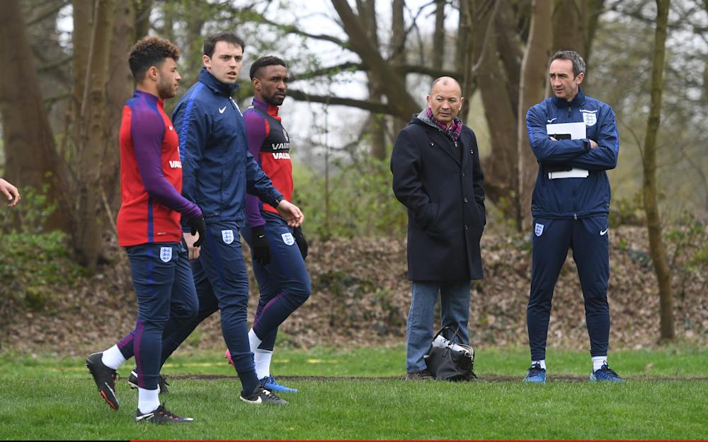 Eddie Jones (L) speaks with Dave Redding the FA head of performance services during England Training Session at The Grove Hotel - Credit: The FA via Getty Images