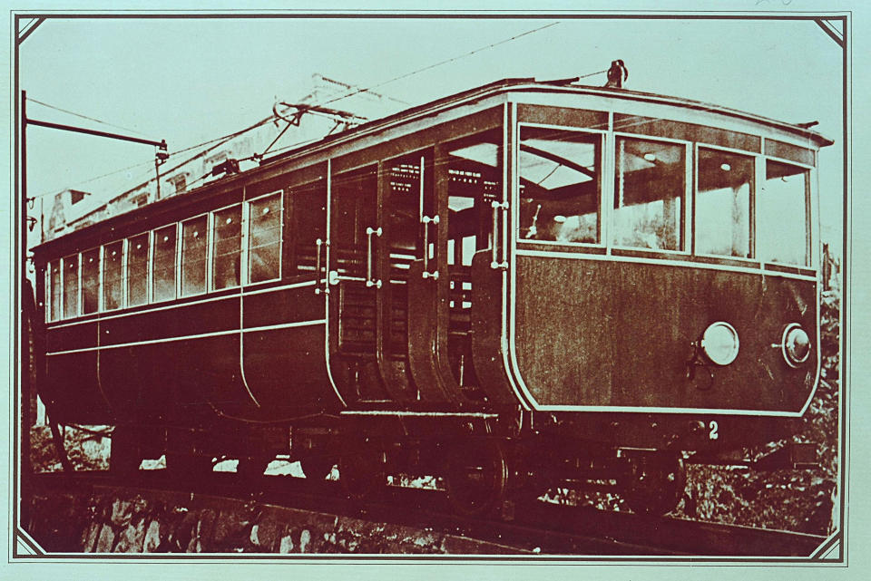 In this undated photo provided by Hong Kong Peak Tramways, a 2nd generation Peak Tram which serviced from 1926 to 1948 is seen in Hong Kong. The Peak Tram started operations in 1888, when Hong Kong was a British colony, to transport people up Victoria Peak instead of using sedan chairs. The original carriages were made of varnished timber and seated 30 passengers in three classes. (Hong Kong Peak Tramways via AP)