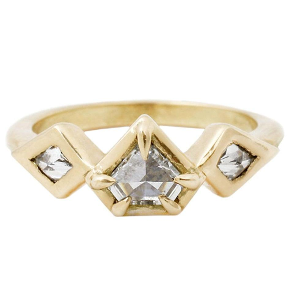 """<p>The <a href=""""https://www.popsugar.com/buy/Demi-Prism-Ring-531764?p_name=Demi%20Prism%20Ring&retailer=laurenwolfjewelry.com&pid=531764&price=4%2C200&evar1=fab%3Aus&evar9=47015200&evar98=https%3A%2F%2Fwww.popsugar.com%2Ffashion%2Fphoto-gallery%2F47015200%2Fimage%2F47015969%2FYellow-Gold-Demi-Prism-Ring&list1=shopping%2Cjewelry%2Crings%2Cengagement%20rings&prop13=mobile&pdata=1"""" rel=""""nofollow noopener"""" class=""""link rapid-noclick-resp"""" target=""""_blank"""" data-ylk=""""slk:Demi Prism Ring"""">Demi Prism Ring</a> ($4,200) is equal parts unique and trendsetting. The geometric shape adds an eye-catching punch.</p>"""