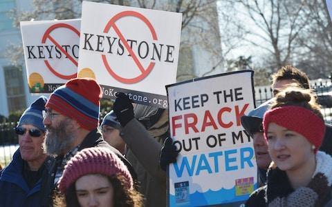 Activists protest after Mr Trump approved the US-Canada Keystone XL oil pipeline, saying it would create jobs and improve America's energy security - Credit: Mandel Ngan/AFP