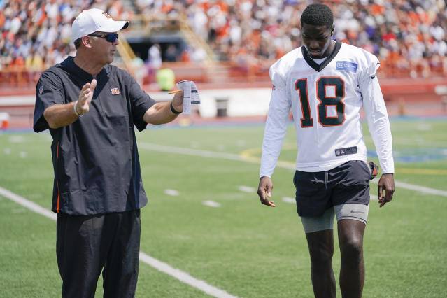 Cincinnati Bengal wide receiver A.J. Green (18) receives instruction from receivers coach Bob Bicknell during the first day of NFL football training camp Saturday, July 27, 2019, in Dayton, Ohio. (AP Photo/Bryan Woolston)