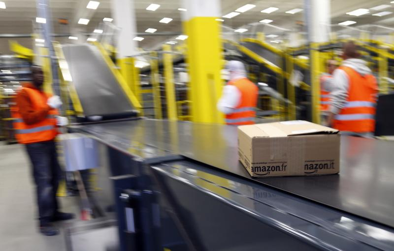 A parcel travels along a conveyer belt at Amazon's new distribution center in Brieselang