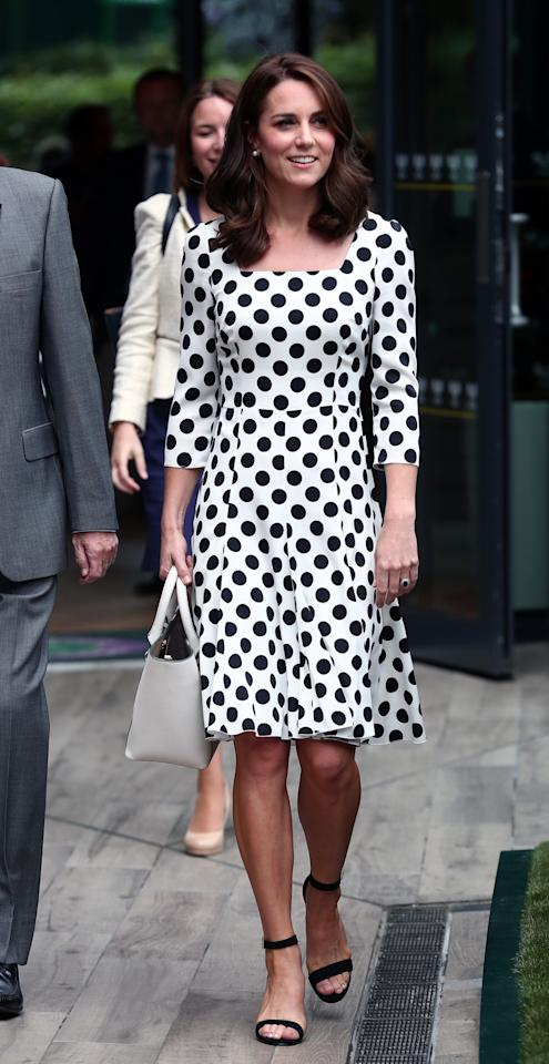 <p>The Duchess arrived for the first day of Wimbledon in a stand-out polka dot dress by Dolce & Gabbana. Sporting a brand new shorter hairstyle, Kate paired the £930 dress with block-heeled sandals and a white leather bag.<br /><i>[Photo: PA]</i> </p>