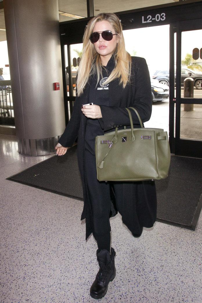 <p>The pregnant reality star hit LAX in mid-November wearing a comfortable all-black ensemble with an olive green Birkin bag hiding her baby bump. </p>