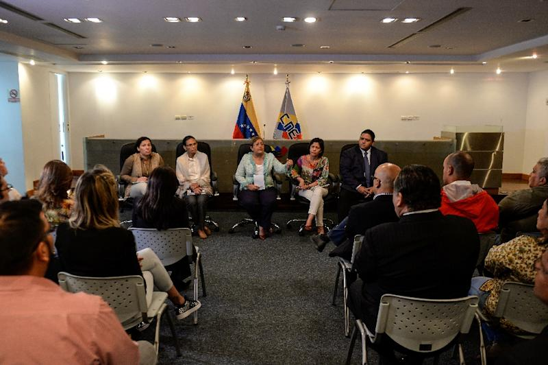 Members of the Venezuelan National Electoral Council during a meeting with members of the ruling party at the CNE headquarters in Caracas, on May 2, 2016