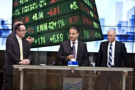 Robert J. Coury, Chairman and Chief Executive Officer of Mylan (C) stands next to Amnon Neubach, the chairman of Tel Aviv Stock Exchange (R) during a bell ringing ceremony at the Tel Aviv Stock Exchange, Israel November 4, 2015. REUTERS/Nir Elias