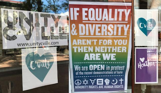 """Signs posted throughout Charlottesville's downtown area in September, a month after the violence of the """"Unite the Right"""" rally."""