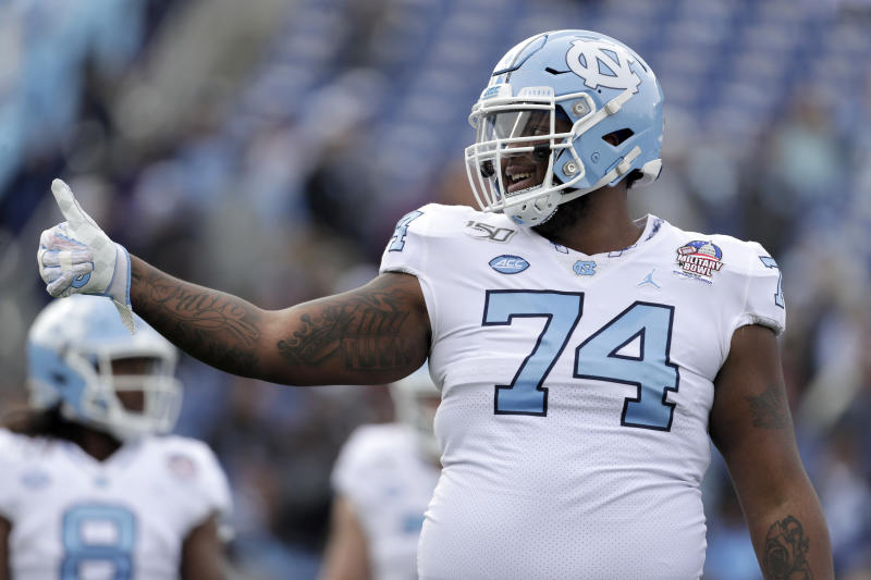 North Carolina offensive lineman Jordan Tucker gestures toward an official during the first half of the Military Bowl NCAA college football game against Temple, Friday, Dec. 27, 2019, in Annapolis, Md. (AP Photo/Julio Cortez)
