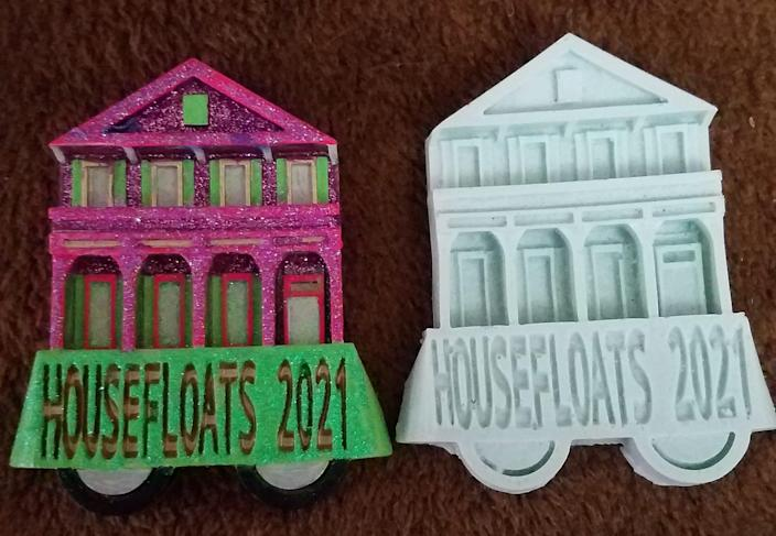 "Official ""Krewe of House Floats"" molds created by Algiers Point resident Derek Gorsuch. The signature throw will be available at dozens of house floats across New Orleans this Mardi Gras season."