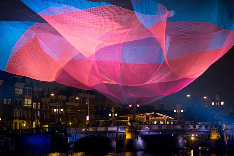 U.S. artist Janet Echelman's artwork 1.26 Amsterdam spans Amstel river during the opening of the Amsterdam Light Festival . The artwork refers to the earthquake in Chili of February 2010 that reduced the day by 1.26 microsecondsNetherlands Amsterdam Light Festival, Amsterdam, Netherlands