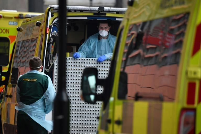 Paramedics prepare an ambulance outside the Royal London Hospital in east London amid warnings health services in the city risk being overwhelmed as infections surge