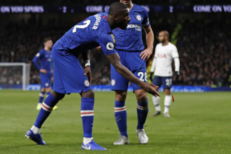 Chelsea's German defender Antonio Rudiger throws an object off the playing surface during the English Premier League football match between Tottenham Hotspur and Chelsea at Tottenham Hotspur Stadium in London, on December 22, 2019. (Photo by Adrian DENNIS / AFP) / RESTRICTED TO EDITORIAL USE. No use with unauthorized audio, video, data, fixture lists, club/league logos or 'live' services. Online in-match use limited to 120 images. An additional 40 images may be used in extra time. No video emulation. Social media in-match use limited to 120 images. An additional 40 images may be used in extra time. No use in betting publications, games or single club/league/player publications. /  (Photo by ADRIAN DENNIS/AFP via Getty Images)