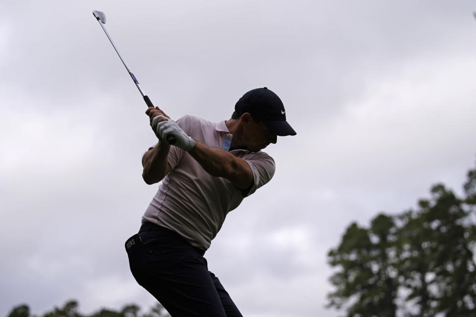 Rory McIlroy, of Northern Ireland, tees off on the 16th hole during a practice round for the Masters golf tournament Tuesday, Nov. 10, 2020, in Augusta, Ga. (AP Photo/Matt Slocum)
