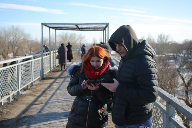 Residents in the hope of catching a signal from cell towers make their calls from a bridge outside Donetsk, one of the few places available for mobile connection by Vodafone Ukraine in the rebel stronghold in the east of the country