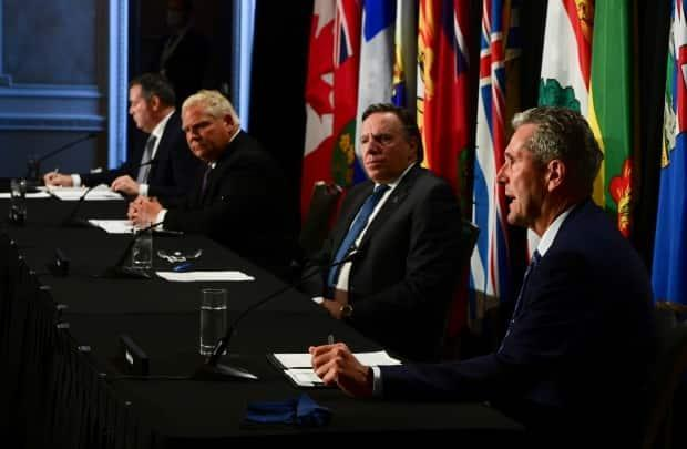 Manitoba Premier Brian Pallister, right, speaks as Quebec Premier Francois Legault, Ontario Premier Doug Ford and Alberta Premier Jason Kenney look on during a press conference in Ottawa on Friday, Sept. 18, 2020.