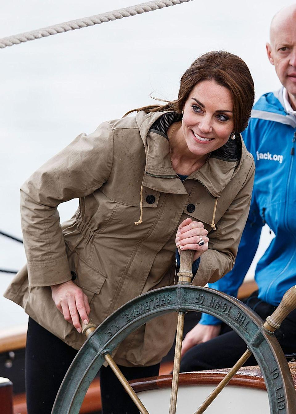 """<p>Kate got nautical while steering the Pacific Grace ship in <a href=""""https://www.townandcountrymag.com/style/fashion-trends/g2877/kate-middleton-royal-canada-tour-outfits/"""" rel=""""nofollow noopener"""" target=""""_blank"""" data-ylk=""""slk:Canada's Victoria Harbour"""" class=""""link rapid-noclick-resp"""">Canada's Victoria Harbour</a>. She chose a sporty khaki anorak for the outing. </p>"""