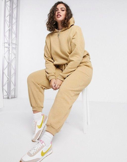 "<p><strong>Asos</strong></p><p>us.asos.com</p><p><strong>$64.00</strong></p><p><a href=""https://go.redirectingat.com?id=74968X1596630&url=https%3A%2F%2Fwww.asos.com%2Fus%2Fasos-curve%2Fasos-design-curve-premium-tracksuit-hoody-basic-jogger-with-pocket-details-in-neppy-in-sand%2Fprd%2F20664086&sref=https%3A%2F%2Fwww.cosmopolitan.com%2Fstyle-beauty%2Ffashion%2Fg33456487%2Fbest-hoodies-for-women%2F"" rel=""nofollow noopener"" target=""_blank"" data-ylk=""slk:Shop Now"" class=""link rapid-noclick-resp"">Shop Now</a></p><p>Go for a monochrome look with a sneaker for a casual yet super put-together outfit. </p>"