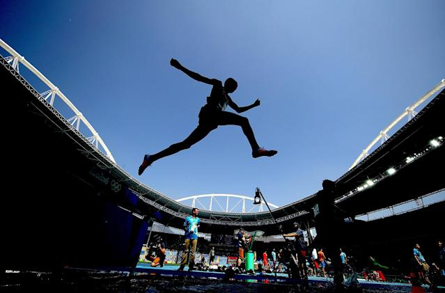 <p>Yemane Haileselassie of Eritrea competes in the Men's 3000m Steeplechase Final on Day 12 of the Rio 2016 Olympic Games at the Olympic Stadium on August 17, 2016 in Rio de Janeiro, Brazil. (Photo by Cameron Spencer/Getty Images) </p>