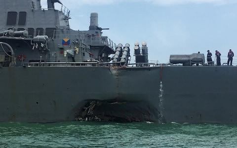 Damage on the US Navy guided-missile destroyer USS John S. McCain after a collision - Credit: Reuters