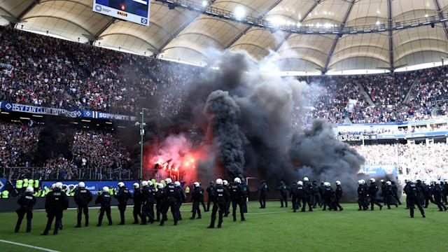 Victory on the final day was not enough to preserve Bundesliga status HSV and flares and black smoke filled the pitch in stoppage time