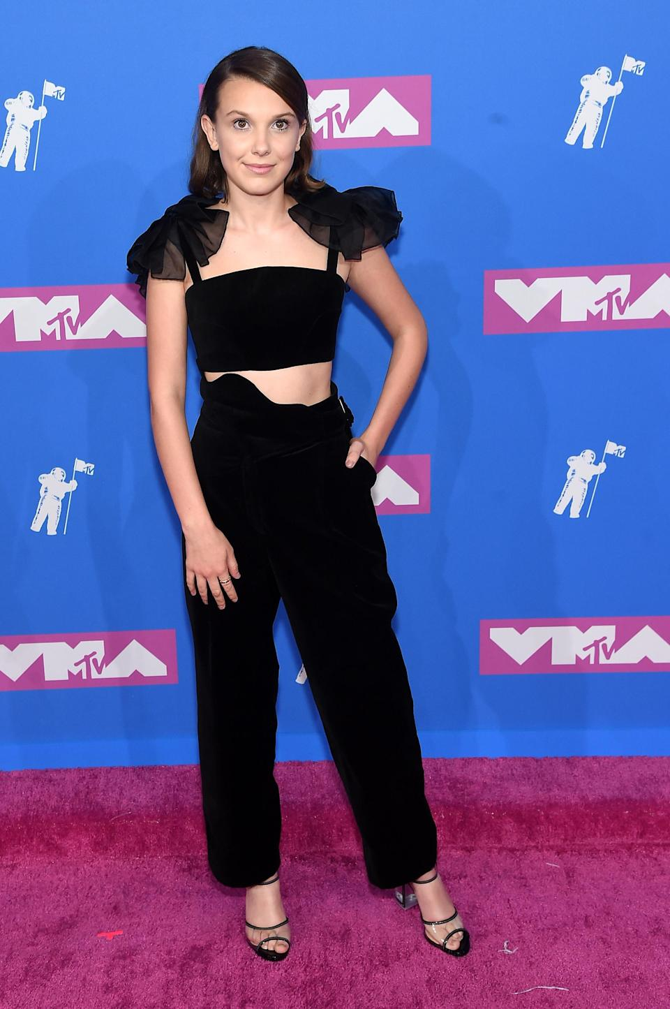 <p>The 'Stranger Things' star looked chic in a Rosie Assoulin crop top and trousers combo. [Photo: Getty] </p>
