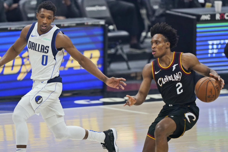 Cleveland Cavaliers' Collin Sexton (2) drives against Dallas Mavericks' Josh Richardson (0) during the first half of an NBA basketball game, Sunday, May 9, 2021, in Cleveland. (AP Photo/Tony Dejak)