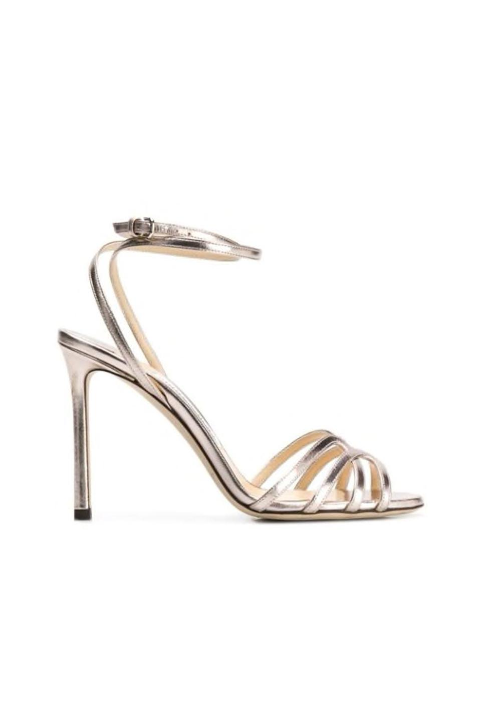 """<p><strong>Jimmy Choo</strong></p><p>farfetch.com</p><p><strong>$825.00</strong></p><p><a href=""""https://go.redirectingat.com?id=74968X1596630&url=https%3A%2F%2Fwww.farfetch.com%2Fshopping%2Fwomen%2Fjimmy-choo-platinum-mimi-100-sandals-item-13544599.aspx&sref=https%3A%2F%2Fwww.townandcountrymag.com%2Fstyle%2Ffashion-trends%2Fg36544376%2Fbest-metallic-accessories%2F"""" rel=""""nofollow noopener"""" target=""""_blank"""" data-ylk=""""slk:Shop Now"""" class=""""link rapid-noclick-resp"""">Shop Now</a></p><p>Is there anything more glamorous than sky high silver Jimmy Choos? Obviously not. If you can only splurge on one pair, a metallic like silver will go farther than basic black, as it looks great with every color. </p>"""