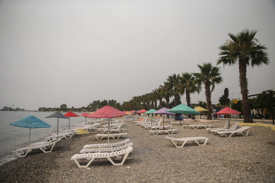 The Oren beach near the Kemerkoy Power Plant, a coal-fueled power plant, in Milas, Mugla in southwest Turkey, Thursday, Aug. 5, 2021. A wildfire that reached the compound of a coal-fueled power plant in southwest Turkey and forced evacuations by boats and cars, was contained on Thursday after raging for some 11 hours, officials and media reports said. (AP Photo/Emre Tazegul)