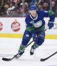Vancouver Canucks' Brock Boeser passes the puck during the third period of an NHL hockey game against the Calgary Flames on Saturday, Feb. 8, 2020, in Vancouver, British Columbia. (Darryl Dyck/The Canadian Press via AP)
