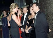 <p>At the London premiere of <em>Apollo 13, </em>Rita Wilson wore a chic black velvet evening gown, while Tom Hanks chose a black tuxedo. The film's director, Ron Howard, looked on.<br></p>