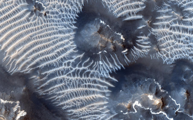 <p>A view of the Noctis Labyrinthus region of Mars, perched high on the Tharsis rise in the upper reaches of the Valles Marineris canyon system, is seen in this NASA handout picture acquired on Aug. 31, 2013, by the HiRISE (High Resolution Imaging Science Experiment) instrument aboard NASA's Mars Reconnaissance Orbiter (MRO). (Photo: NASA/JPL-Caltech/Univ. of Arizona/Reuters) </p>