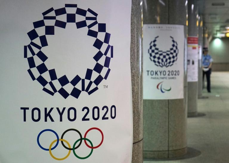 Logos for the 2020 Olympic Games at a subway station in Tokyo