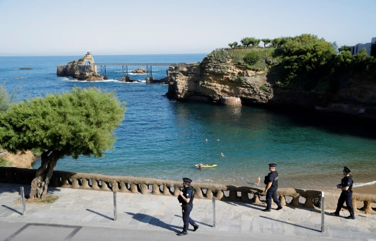French CRS police patrol in Biarritz, as the resort city is locked down ahead of the G7 summit