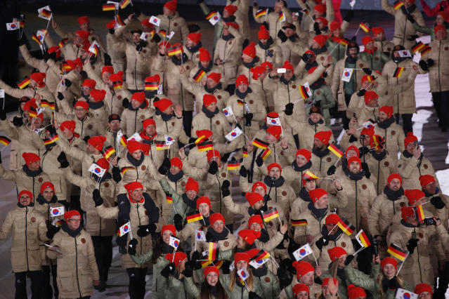 <p>Germany athletes wave flags during the opening ceremony of the 2018 Winter Olympics in Pyeongchang, South Korea, Friday, Feb. 9, 2018. (AP Photo/Christophe Ena) </p>