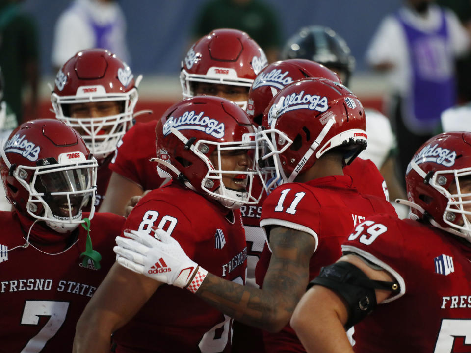 Fresno State tight end Juan Rodriguez, center, celebrates his touchdown against Hawaii with teammate Josh Kelly during the first half of an NCAA college football game in Fresno, Calif., Saturday, Oct. 24, 2020. (AP Photo/Gary Kazanjian)