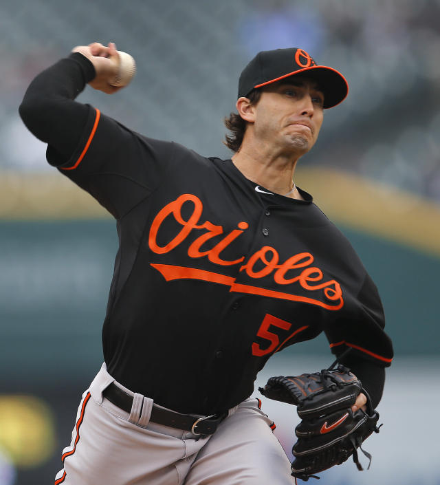 Baltimore Orioles pitcher Miguel Gonzalez throws against the Detroit Tigers in the first inning of a baseball game in Detroit, Friday, April 4, 2014. (AP Photo/Paul Sancya)
