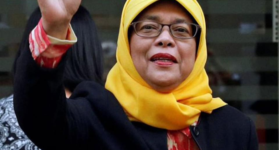 Former speaker of Singapore's parliament, Halimah Yacob, arrives at the Elections Department after she was given the certificate of eligibility to contest the election by the Presidential Elections Committee in Singapore September 11, 2017. REUTERS/Edgar Su