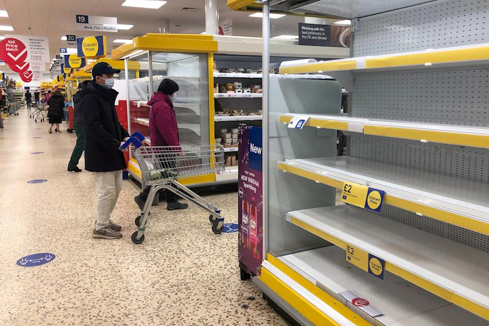 Bare shelves at a Tesco superstore in Cambridge, ahead of a national lockdown for England from Thursday. (Photo by Joe Giddens/PA Images via Getty Images)