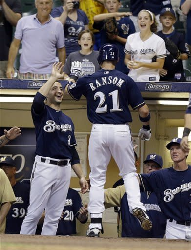 Milwaukee Brewers' Cody Ransom (21) gets a high-five from Ryan Braun, left, after Ransom's three-run home run against the Houston Astros during the eighth inning of a baseball game Monday, July 30, 2012, in Milwaukee. (AP Photo/Jeffrey Phelps)