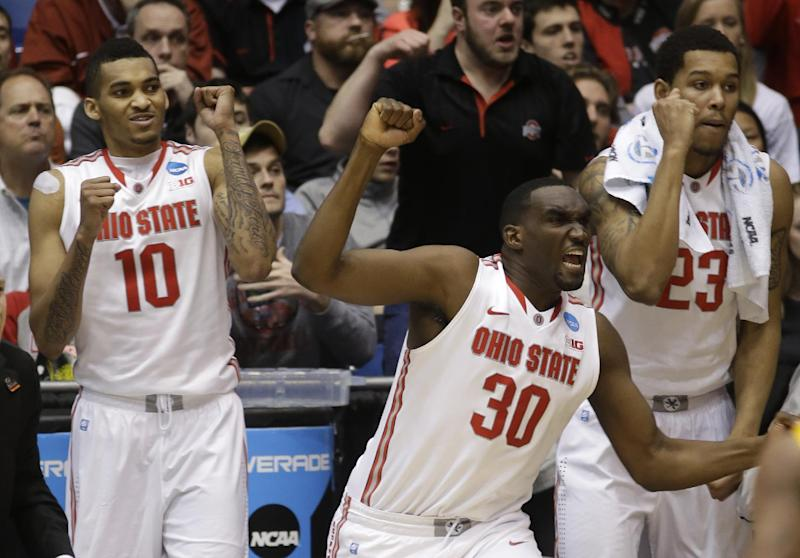 Ohio State players LaQuinton Ross (10), Evan Ravenel (30) and Amir Williams (23) celebrate on the bench in the second half of a third-round game against Iowa State in the NCAA college basketball tournament on Sunday, March 24, 2013, in Dayton, Ohio. Ohio State defeated Iowa State 78-75. (AP Photo/Al Behrman)