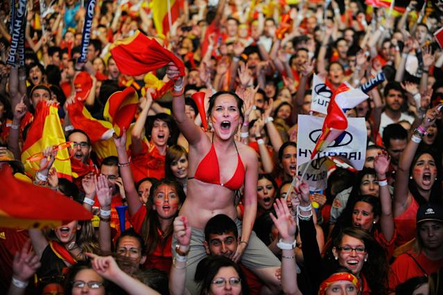 MADRID, SPAIN - JULY 01: Spain fans celebrate watching the UEFA EURO 2012 final match between Spain and Italy on a giant outdoor screen on Paseo de la Castellana on July 1, 2012 in Madrid, Spain. (Photo by Denis Doyle/Getty Images)