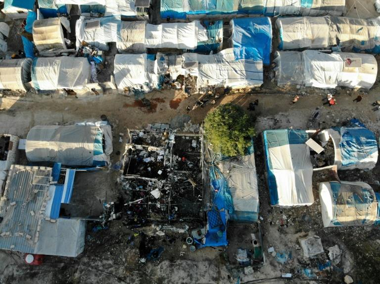 An aerial view taken on November 21, 2019 shows the charred remains of a tent following Syrian regime bombardment on a makeshift camp for the displaced in the village of Qah near the Turkish border (AFP Photo/Omar HAJ KADOUR)