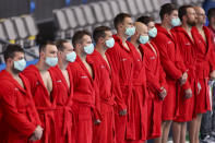 <p>Team Hungary players line wearing face masks during the Men's Preliminary Round Group A match between Hungary and Greece on day two of the Tokyo 2020 Olympic Games at Tatsumi Water Polo Centre on July 25, 2021 in Tokyo, Japan. (Photo by Leon Neal/Getty Images)</p>
