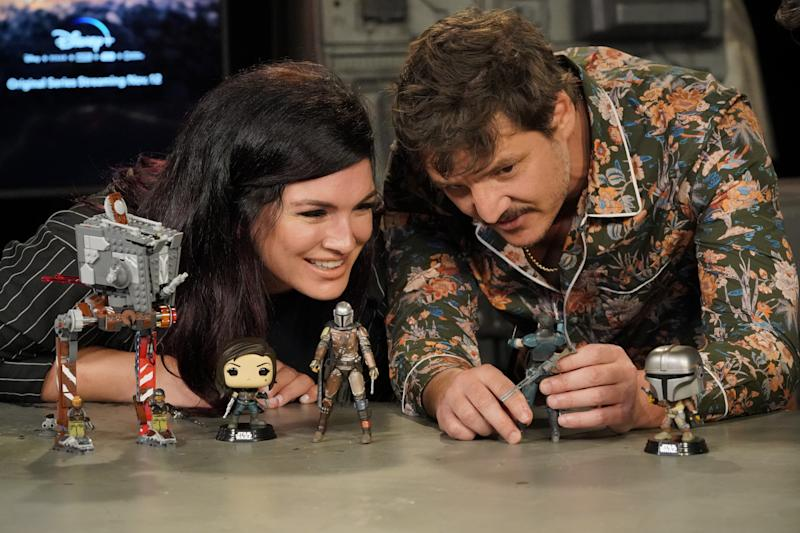 Gina Carano and Pedro Pascal check out all the 'Mandalorian' toys that will be on sale on Triple Force Friday (Photo: Lisa Rose/Lucasfilm)