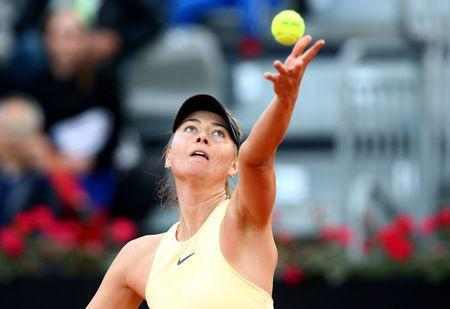 FILE PHOTO: Tennis - WTA Premier 5 - Italian Open - Foro Italico, Rome, Italy - May 15, 2018 Russia's Maria Sharapova in action during her first round match against Australia's Ashleigh Barty REUTERS/Alessandro Bianchi/File Photo