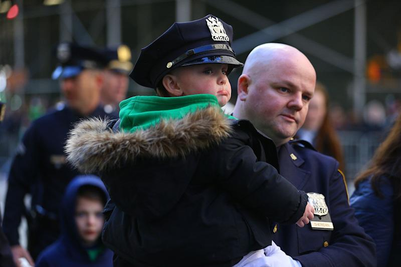 The son of a New York City police officer gets a ride as his dad marches in the St. Patrick's Day parade on March 16, 2019, in New York. (Photo: Gordon Donovan/Yahoo News)