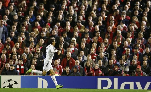 Real Madrid's Cristiano Ronaldo celebrates after scoring a goal against Liverpool during their Champions League Group B soccer match at Anfield in Liverpool, northern England October 22, 2014. REUTERS/Phil Noble (BRITAIN - Tags: SOCCER SPORT)