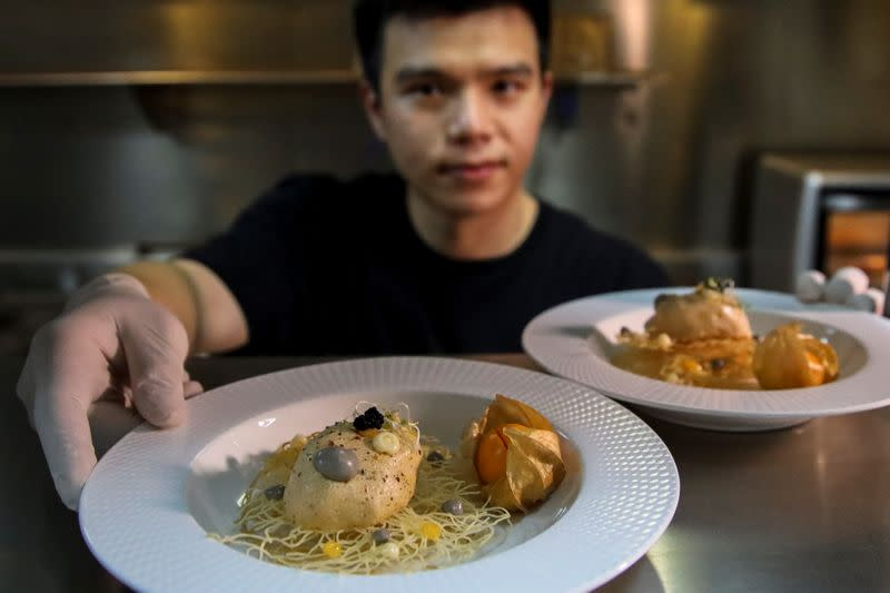 Thai inventor Sorawut Kittibanthorn presents food dishes made from chicken feather at a kitchen in Bangkok