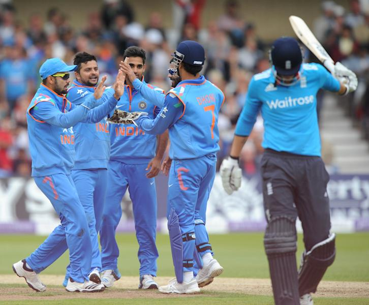 India's Suresh Raina (L) celebrates with team mates after taking the wicket of England's Alex Hales (R) for 42 runs during the third one-day international cricket match between England and India at Trent Bridge in Nottingham on August 30, 2014 RESTRICTED TO EDITORIAL USE. NO ASSOCIATION WITH DIRECT COMPETITOR OF SPONSOR, PARTNER, OR SUPPLIER OF THE ECB (AFP Photo/Olly Greenwood)
